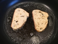 Soaked bread added to buttered skillet.