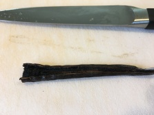 Vanilla bean, split in half and ready to be scraped.