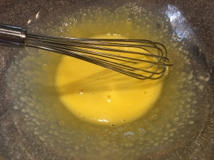 Yolks and water whisked until lightened.