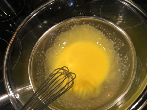 Yolks placed over simmering water.
