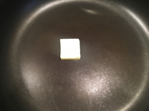 Butter in large skillet.