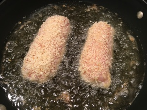 Breaded chicken in hot oil.
