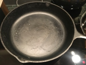 Cast iron skillet, heating over medium heat.