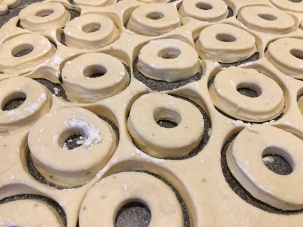 Doughnut shapes cut using pastry rings.