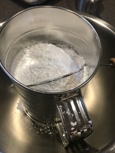 Sifting powdered sugar.