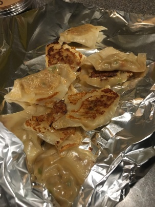 Potstickers transferred to foil cone to keep warm in the oven.