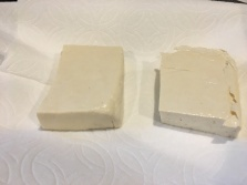 Firm tofu, cut in half and left on paper towels to drain.
