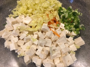 Cubed tofu, grated carrot, Napa cabbage, and scallions.