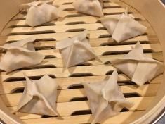 Dumplings in steamer.