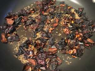 Chiles and cumin seeds after toasting.