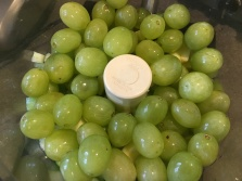A pound of green grapes added to the food processor.