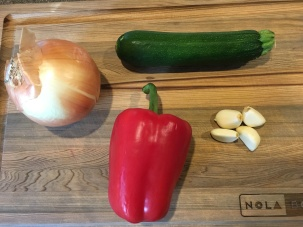 Vegetables for veggie spread: onion, zucchini, garlic, and red bell pepper.