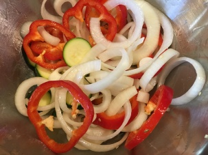 Zucchini, red bell pepper, onion, and garlic tossed with olive oil.