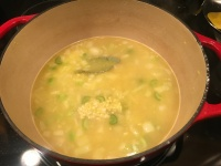 Bay leaf and garlic added to soup.