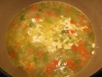 Cream added to soup and bay leaf removed.