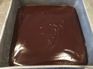 "Ganache poured into 8x8"" pan."