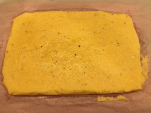 Cooled polenta flipped onto cutting board.