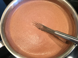 Bringing pudding mix to a boil.