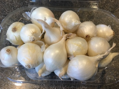 Unpeeled pearl onions.