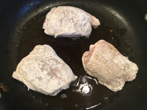 Chicken pieces browning in pork fat.