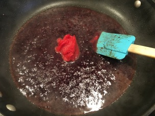 Tomato paste added to deglazing liquid.