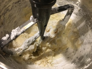 Sifted powdered sugar and vanilla added to cream cheese/butter mixture.
