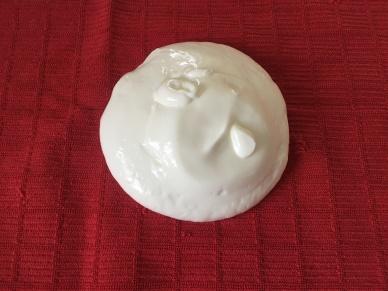 Yogurt placed on a tea towel.