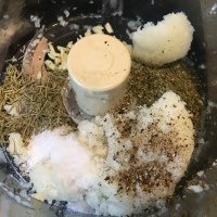 Drained onion placed back in food processor, along with garlic, rosemary, marjoram, pepper, and Kosher salt.