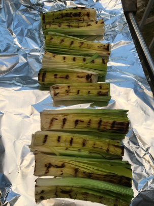 Leeks transferred to foil after grilling for 3 minutes.
