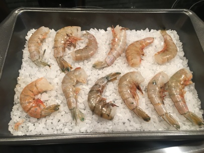 "Shrimp placed on top of hot salt in 9x13"" pan."