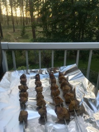 Alton's beef skewers, cooked and ready to rest in foil.