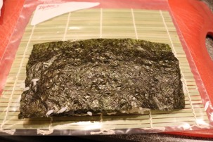 Nori and rice flipped over.