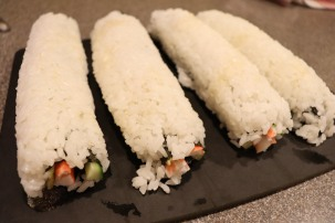 Four finished California rolls.