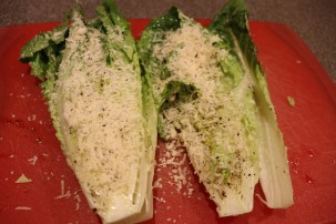 Romaine hearts after dipping/pressing into grated Parmesan.