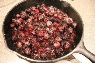 Berry and sugar mixture in cast iron skillet.