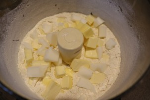 Lard and butter added to flour.