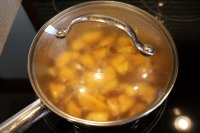 Simmering the mango filling after bringing it to a boil.