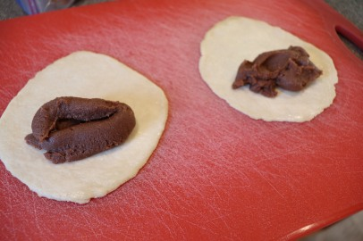 Chocolate filling on dough.
