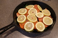 More lemon placed on top of fish.